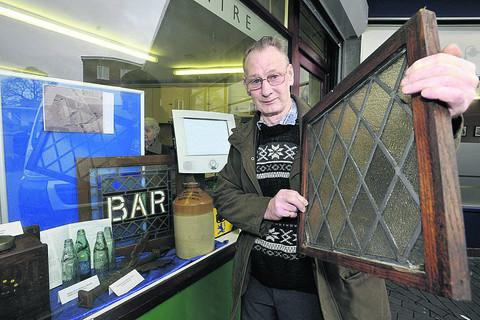 This Is Wiltshire: Derek Whale with items rescued from the recently demolished Oak Inn in Warminster Road, holding one of the windows from the snug bar