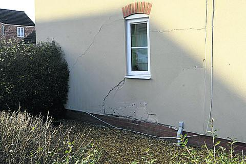 This Is Wiltshire: The house on the corner of Old Farm Road and West Ashton Road, Trowbridge, damaged after being hit by a car on Friday