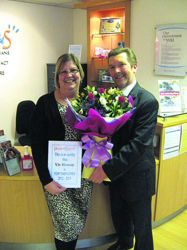 Winner Viv Howse with optometrist and partner Keith Bottomley
