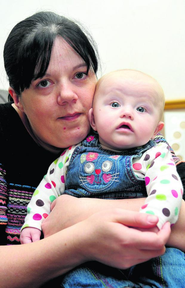 Lisa Blackburn with her daughter Megan, who was born with a cleft palate