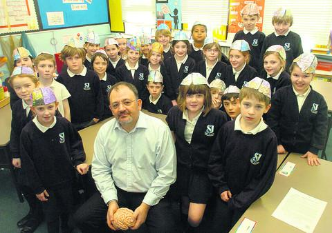 This Is Wiltshire: Experimental psychologist Dr David Turk with pupils from St Joseph's Catholic Primary School