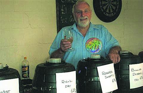 This Is Wiltshire: Michael Bishop, pictured at a cider festival held at the Dog and Fox in Ashley which marked his 70th birthday