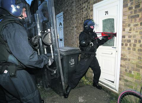 One of the raids by police in Toothill