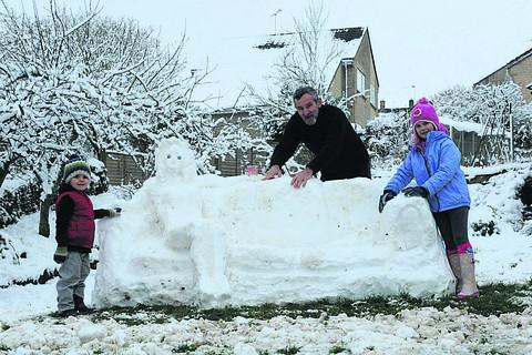 This Is Wiltshire: Phil Courage helped by three-year-old William Stacey and sister Mara, seven, at the weekend