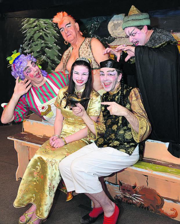 Pictured, clockwise from left, Steve Gill (Widow Twankey), Dave Grafton (Genie), Steven Horton (Abenaza), Dave Willett (Aladdin), Elysse Cummins (Princess)