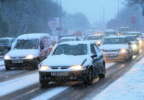 This Is Wiltshire: Motorists struggle along Great Western Way in the snow last Friday