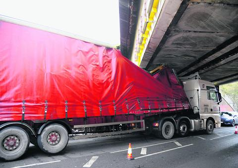 This Is Wiltshire: The lorry wedged under the Running Horse Bridge at Wootton Bassett Road