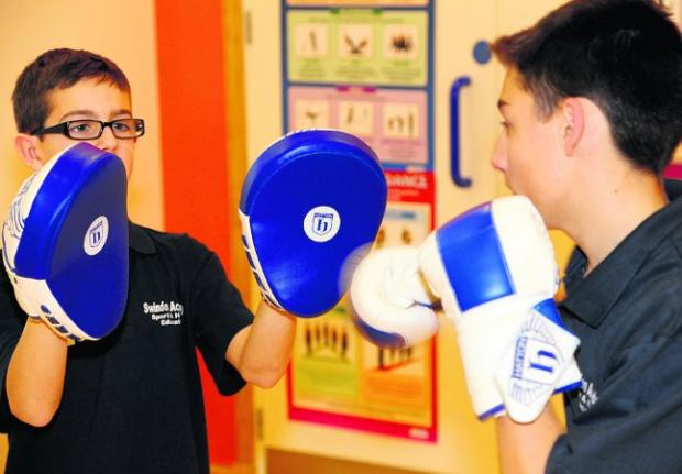 This Is Wiltshire: boxing clever Rob and Jordan take part in the Scrappers boxing session Picture: DAVE COX