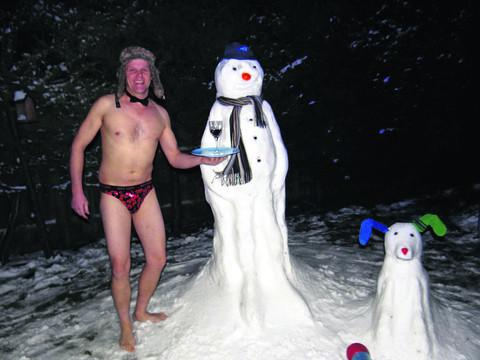 This Is Wiltshire: Wayne Bawden dares to be almost bare as he presents a glass of cheer to his snowman