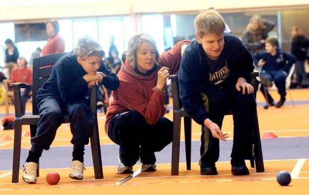 Ashley, Rebecca Howell and Callum Ingram try Boccia