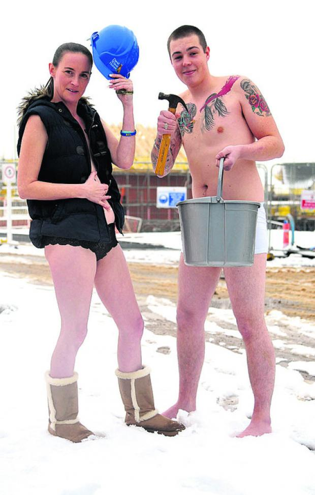 This Is Wiltshire: Marie Hughes and Jamie Madden strip off at a building site at Royal Wootton Bassett