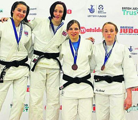 This Is Wiltshire: Jemima Duxberry, left, with, left to right, winner Faith Pitman and senior U63kgs bronze medallists Lucy Renshall Kate Harris in Sheffield