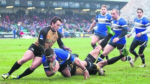 om Dunn charges over the line for his first Bath try during the 53-8 win over Bucharest Wolves on Saturday (Picture by Mervyn Clingan/takingpictures-sport.co.uk)