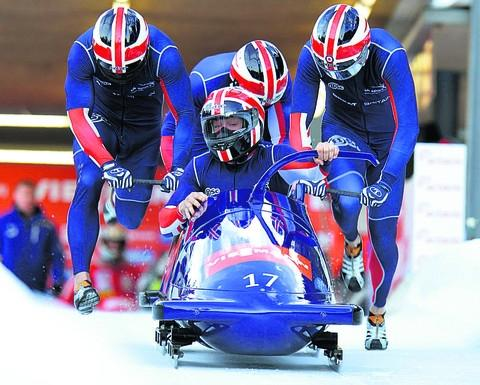 John Jackson, front, and teammates at the start of the four-man race in Igls on Sunday