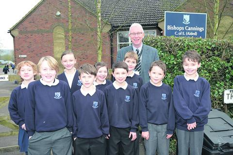 This Is Wiltshire: Jonathan Barber, the new head teacher at Bishops Cannings Primary School, with pupils