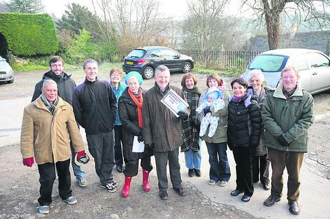 This Is Wiltshire: David Maude celebrates the Conigre Hill parking takeover with fellow members of the Hillside Community Interest Company