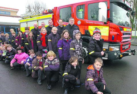 This Is Wiltshire: Pupils from Chippenham's Queens Cresent school with firefighters