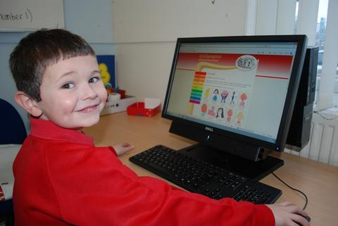 Aidan Cartwright, aged 6, uses the new school website.