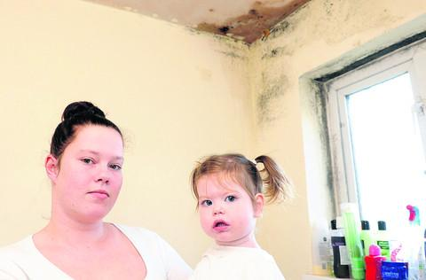Rebeka Lound has damp in her council flat, which she says is affected the health of her daughter, Ruby-Lou