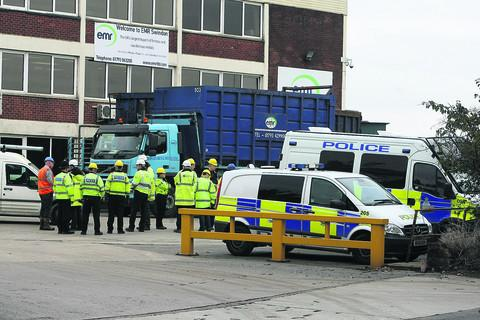 This Is Wiltshire: Police and other agencies pictured at EMR in Swindon checking for stolen metal as part of Operation Tornado