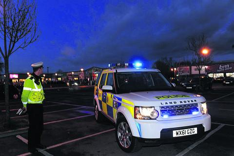 This Is Wiltshire: Police patrol the Bradley Road retail park before Christmas