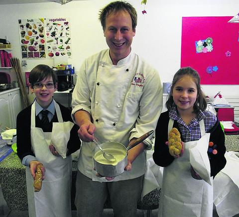 Duncan and Izzy from Class 5W of St Margaret's Prep School, Calne, with Peter Vaughan