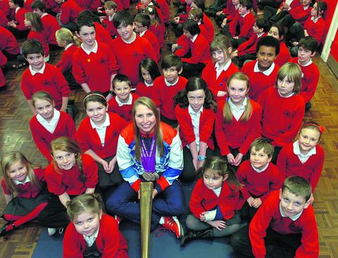 This Is Wiltshire: Stephanie Millward shows off her medals to Wansdyke pupils