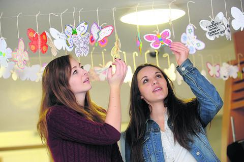 This Is Wiltshire: Brontë Jones and Katie Blake with butterflies they made to mark Holocaust Memorial Day