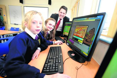 This Is Wiltshire: Chippenham MP Duncan Hames with pupils Stacey Pegler and Portia Grant in Sheldon School's new learning support facility