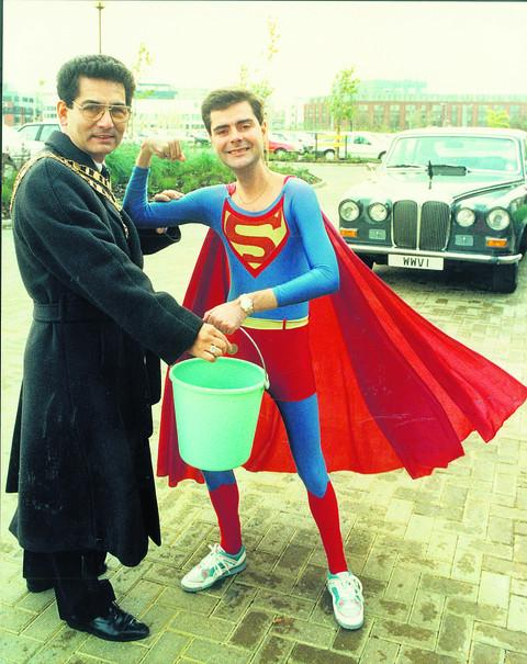 Kevin Duffield, the former Mr Puniverse, collects 50p from then Swindon mayor Derique Montaut at British Telecom's North Star Avenue car park in November 1990