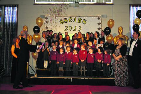 This Is Wiltshire: Pupils and staff of Corsham Primary School take to the stage for their Oscars-style awards ceremony to honour their achievements