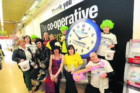 This Is Wiltshire: Staff from the Malmesbury Co-op who dressed up to rock around the clock for charity