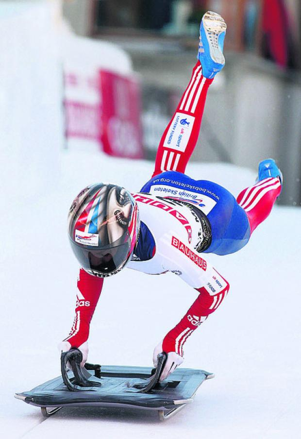 This Is Wiltshire: Shelley Rudman starts her first run during the women's Skeleton World Championship in St. Moritz, Switzerland this morning