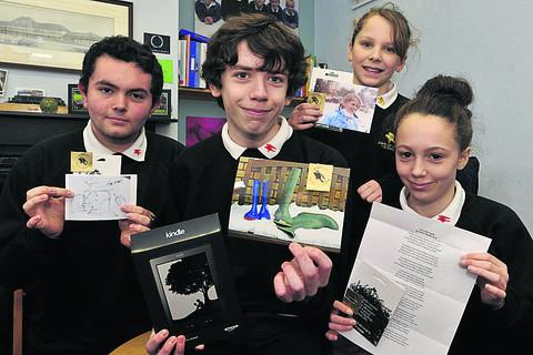 This Is Wiltshire: Oliver Bailey, centre, winner of the snow pictures and poetry competition, with runners-up Danny Purnell, left, Eloise Sutton, picking up a prize on behalf of sister Sophie, and Caitlin Wosika, right