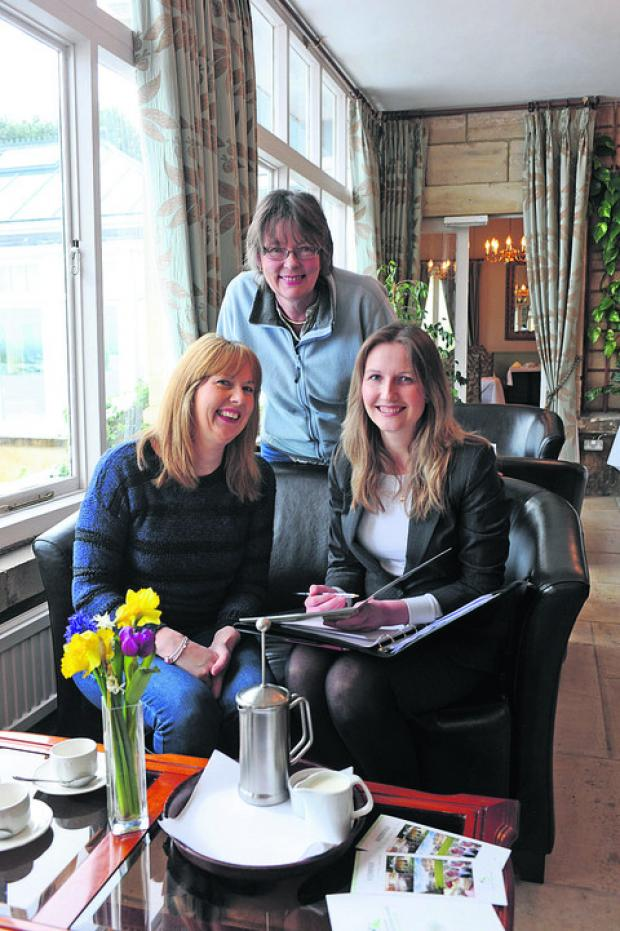 This Is Wiltshire: Leigh Park Hotel wedding co-ordinator Louise Rathband, seated right, runs through arrangements with Lisa Richardson, left, and mother Mary Cowler