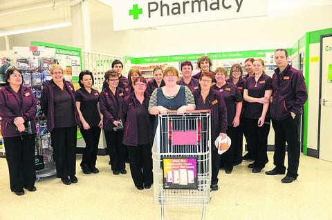 This Is Wiltshire: Sainsbury's staff see Emma Corke prepare to start her dash
