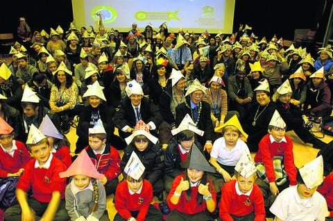 This Is Wiltshire: Chippenham mayor and mayoress Andy and Nina Phillips with children taking part an world record attempt for paper hat wearing