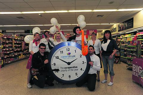 This Is Wiltshire: Manager Rob Mead and staff at the Co-operative food store in fancy dress for their rock and roll themed fundraising launch