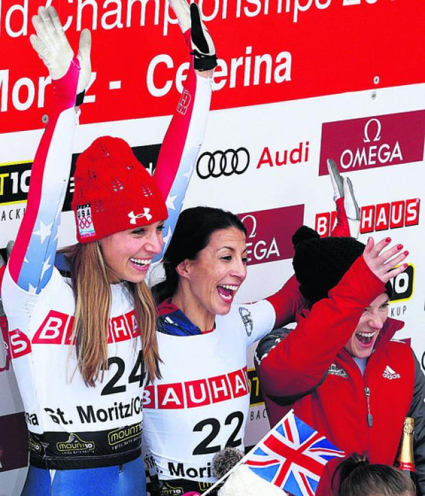 This Is Wiltshire: Shelley Rudman (middle) celebrates her World Championship triumph with silver medallist America's Noelle Pikus-Pace (left) and bronze winner, Sarah Reid, of Canada (Pictures: AP Photo/Keystone, Arno Balzarini)
