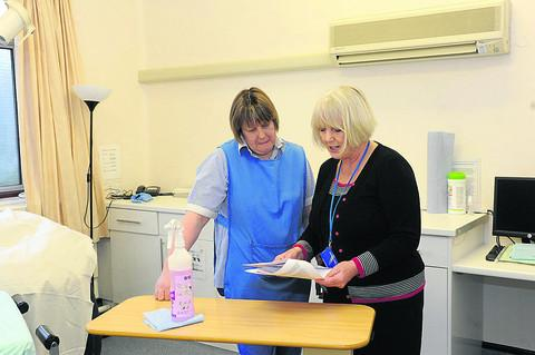 This Is Wiltshire: Matron Beryl Orchard discusses the CQC report, which praises the Trowbridge unit's hygeine standards, with cleaning staff member Samantha Phillips