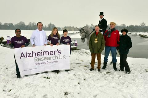 This Is Wiltshire: Jamie and Vicki Graham, right, with staff and supporters of Alzheimer's Research at Badminton