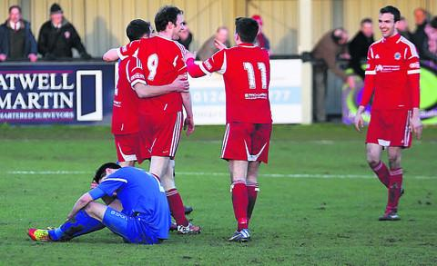 This Is Wiltshire: Chippenham Town's Toby Osman is grounded after Kevin Squire's strike for the final goal during Saturday's 7-1 home defeat by Bideford (Picture by Robin Foster)