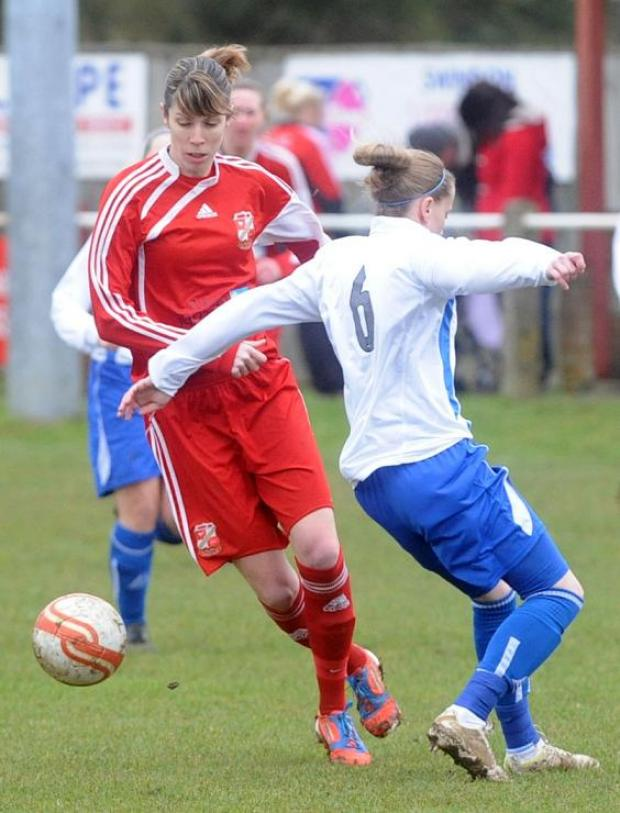 Swindon's Catherine Reid, left, in action on Sunday
