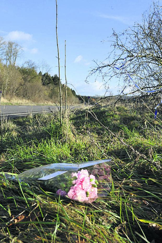 This Is Wiltshire: A floral tribute at the scene of the crash this morning