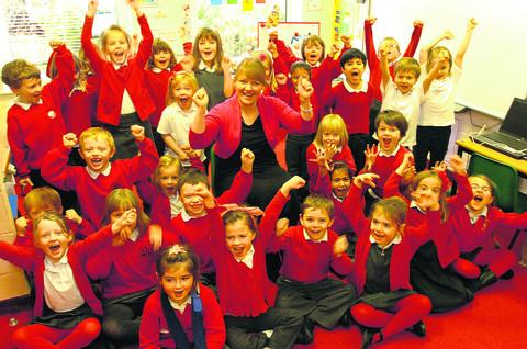 This Is Wiltshire: Headteacher Charlotte Robinson and Year 1 pupils celebrate Wansdyke Primary School's academy status
