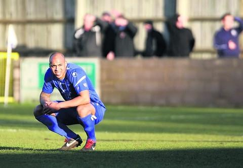 This Is Wiltshire: Bluebirds defender Ashley Williams looks shell-shocked after Town's 7-1 home hammering by Bideford on Saturday – which they followed up with a much-improved display in defeat against Hemel Hempstead Town on Tuesday