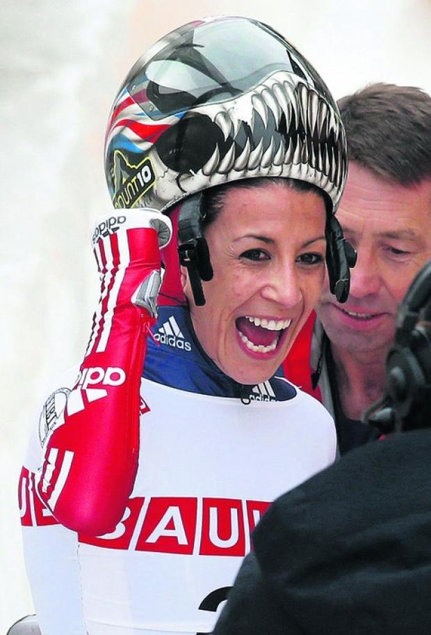 This Is Wiltshire: Shelley Rudman celebrates her victory at the World Championships last Friday