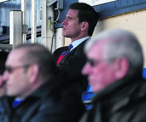 This Is Wiltshire: Chippenham Town manager Nathan Rudge watches on from the stands during last weekend's drubbing by Bideford