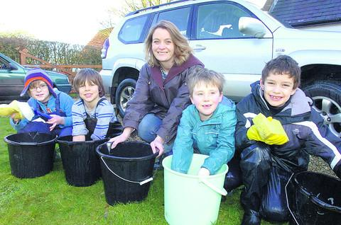 This Is Wiltshire: Mum and governor Claire Cunningham supervises as Ben Cunningham, Manu Ellis, Oliver Mathewson and Byron Taylor get ready to wash cars