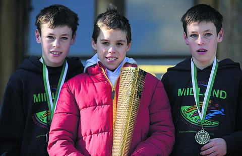 This Is Wiltshire: Junior boys race winner John Howorth, with brother and runner-up Robert and fellow St Augustine's pupil Henry Dixon, centre, who was fifth